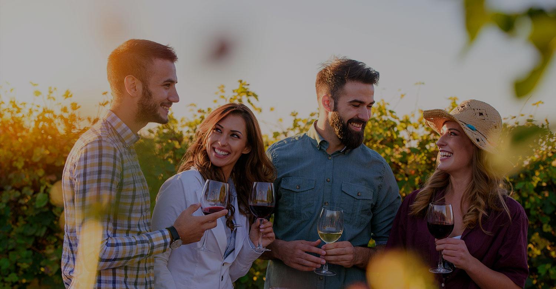 Happy people enjoying wine